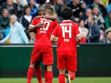 Hakim Ziyech of Twente is congratulated by team mates Kamohelo Mokotjo and Ryo Miyaichi after scoring a goal during the Dutch Eredivisie match between Heracles Almelo and FC Twente at Polman Stadion on September 21, 2014