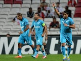 Zenit's Brazilian Hulk (R) celebrates after scoring the opening goal during the UEFA Champions League group C football match against SL Benfica on September 16, 2014