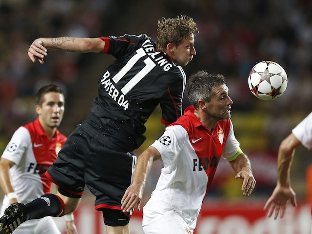 Monaco's French midfielder Jeremy Toulalan (R) vies for the ball with Leverkusen's forward Stefan Kiessling (2nd L) during the Champions League football match on September 16, 2014