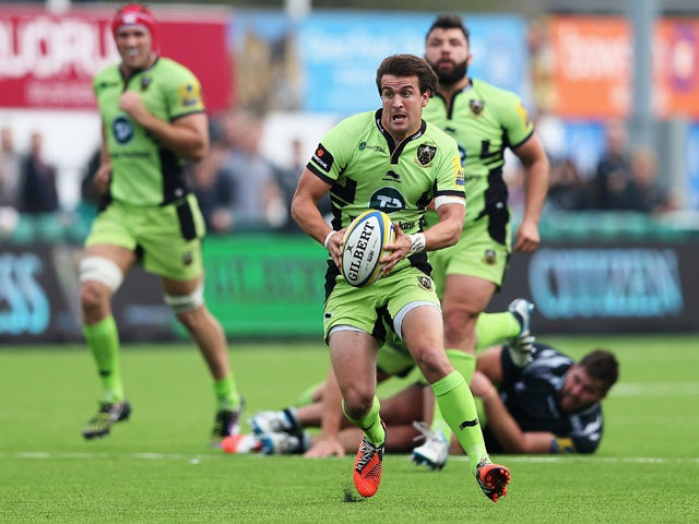 Lee Dickson of Northampton Saints makes a break during the Aviva Premiership match between Newcastle Falcons and Northampton Saints at Kingston Park on September 21, 2014