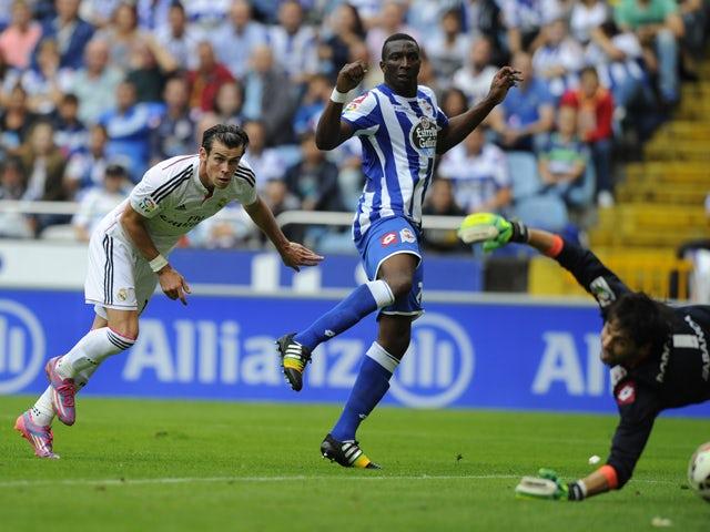Real Madrid's Welsh forward Gareth Bale scores during the Spanish league football match RC Deportivo de la Coruna vs Real Madrid CF at the Municipal de Riazor stadium in La Coruna on September 20, 2014