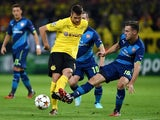 Dortmund's midfielder Sebastian Kehl (L) and Arsenal's Welsh midfielder Aaron Ramsey vie for the ball during the first leg UEFA Champions League Group D football match on September 16, 2014