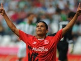 Sevilla's Colombian forward Carlos Bacca celebrates after scoring during the Spanish league football match Cordoba CF vs Sevilla FC at El Nuevo Arcangel stadium in Cordoba on September 21, 2014