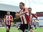 Tommy Smith of Brentford celebrates scoring Brentford's first goal during the Sky Bet Championship match between Brentford and Charlton Athletic at Griffin Park on August 9, 2014