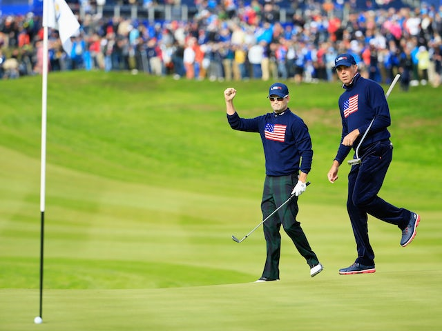 Zach Johnson (L) of the United States celebrates chipping in on the 1st hole with Matt Kuchar during the Afternoon Foursomes of the 2014 Ryder Cup on the PGA Centenary course at Gleneagles on September 27, 2014