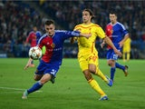 Taulant Xhaka of FC Basel and Lazar Markovic of Liverpool battle for the ball during the UEFA Champions League Group B match between FC Basel 1893 and Liverpool FC at St. Jakob Stadium on October 1, 2014