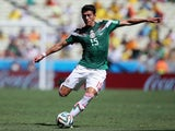 Hector Moreno of Mexico in action during the 2014 FIFA World Cup Brazil Round of 16 match between Netherlands and Mexico at Castelao on June 29, 2014