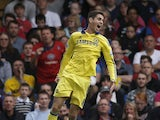 Chelsea's Brazilian midfielder Oscar celebrates scoring the opening goal during tthe English Premier League football match between Crystal Palace and Chelsea at Selhurst Park in south London on October 18, 2014