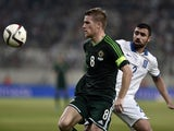Northern Ireland's midfielder Steven Davis vies with Greece's defender Giannis Maniatis during the UEFA Euro 2016 group F qualifying gootball match between Greece and Northern Ireland at the Karaiskaki stadium in Piraeus, near Athens, on October 14, 2014