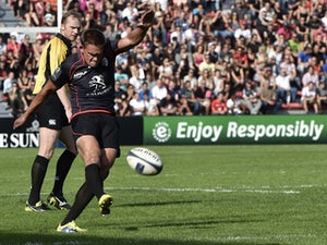 Toulouse's fly-half from England Toby Flood shoots a penalty kick during the European Rugby Champions Cup match between Toulouse and Montpellier at the Ernest Wallon Stadium in Toulouse, southern France, on October 19, 2014