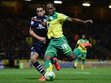 Giuseppe Bellusci of Leeds United battles with Cameron Jerome of Norwich City during the Sky Bet Championship match between Norwich City and Leeds United at Carrow Road on October 21, 2014