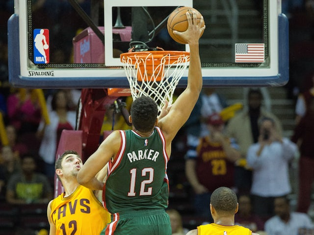 Jabari Parker #12 of the Milwaukee Bucks dunks on the Cleveland Cavaliers during the second half at Quicken Loans Arena on October 14, 2014