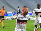 Besiktas' Gokhan Tore celebrates after Besiktas' Demba Ba scored his team's second goal during the UEFA Europa League Group C match Besiktas JK vs FK Partizan on November 6, 2014