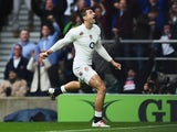 Jonny May of England celebrates scoring the opening try during the QBE International match between England and New Zealand at Twickenham Stadium on November 8, 2014