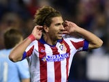 Atletico Madrid's Italian midfielder Alessio Cerci celebrates after scoring their fifth goal during the UEFA Champions League football match against Malmo on November 19, 2014