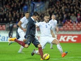 France forward Florian Thauvin fights for the ball with England defender Ben Gibson on November 17, 2014