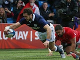 Scotland's centre Alex Dunbar scores a try during the Autumn International rugby union Test match between Scotland and Tonga at Rugby Park in Kilmarnock, Scotland, on November 22, 2014