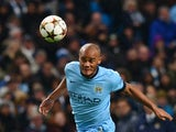 Manchester City's Belgian defender Vincent Kompany heads the ball during the UEFA Champions League Group E football match between Manchester City and Bayern Munich at the Etihad Stadium in Manchester, northwest England, on November 25, 2014