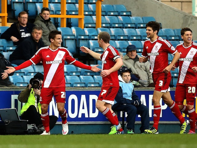 Middlesbrough celebrate with Jelle Vossen after he scores to make it 1-0 during the Sky Bet Championship match against Millwall on December 6, 2014