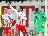 Ajaccio's French midfiedler Johan Cavalli celebrates after scoring a penalty shot during the French League Cup football match Ajaccio (ACA) vs Paris Saint-Germain (PSG) on December 17, 2014