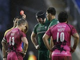 Referee Greg Garner shows a red card to Tom May of London Welsh as Daniel Leo pf London Irish looks on during the Aviva Premiership match on Boxing Day 2014