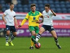 Josh Brownhill of Preston North End battles with Gary Hooper of Norwich City during the FA Cup Third Round match between Preston North End and Norwich City at Deepdale on January 3, 2015