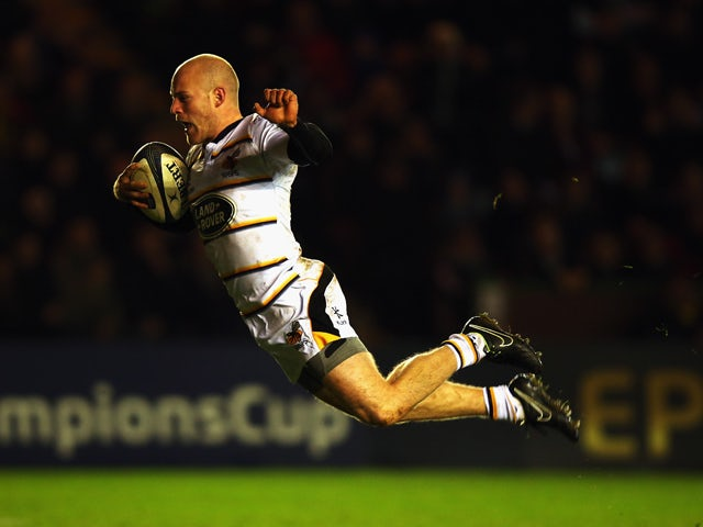 Joe Simpson of Wasps dives into score the second try during the European Rugby Champions Cup match between Harlequins and Wasps at Twickenham Stoop on January 17, 2015