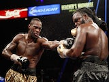 Deontay Wilder (L) connects on WBC heavyweight champion Bermane Stiverne during their title fight at the MGM Grand Garden Arena on January 17, 2015