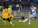 Lazio's forward from Germany Miroslav Klose shoots and scores against AC Milan's goalkeeper from Spain Diego Lopez during the Italian Serie A football match on 24 January, 201