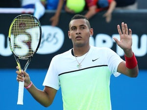 Nick Kyrgios waves to the crowd after his second-round victory on day three of the Australian Open on January 21, 2015