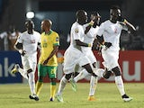 Senegal's defender Kara Mbodji celebrates after scoring a goal during the 2015 African Cup of Nations group C football match between South Africa and Senegal in Mongomo on January 23, 2015