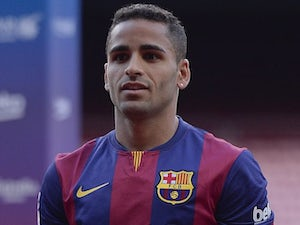 New signing Douglas is unveiled at Barcelona on August 29, 2014