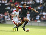 Tyler Walker of Nottingham Forest attempts to move forward with the ball away from George Baldock of MK Dons during the Pre-Season Friendly between MK Dons and Nottingham Forest at Stadium mk on July 27, 2014
