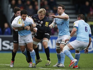 Juan Pablo Socino of Newcastle Falcons is tackled by Jackson Wray and Brad Barritt of Saracens during the Aviva Premiership match on February 28, 2015