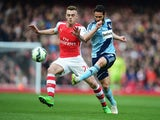 Matthew Jarvis of West Ham United is closed down by Calum Chambers of Arsenal during the Barclays Premier League match between Arsenal and West Ham United at Emirates Stadium on March 14, 2015