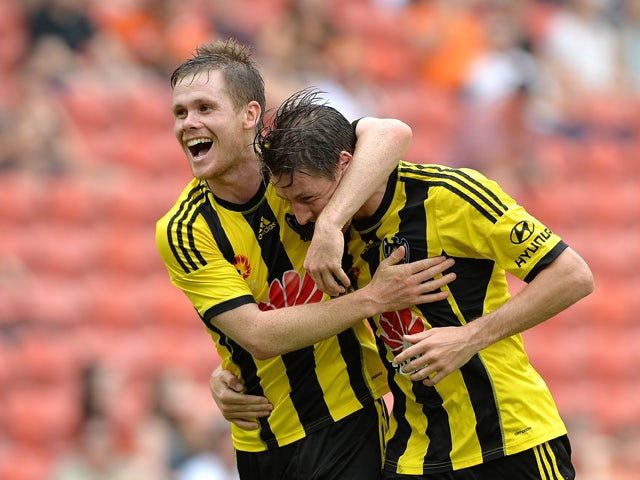 Nathan Burns of Wellington Phoenix is congratulated by team mate Michael McGlinchey after scoring a goal during the round 22 A-League match between the Brisbane Roar and the Wellington Phoenix at Suncorp Stadium on March 22, 2015