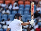 England's batsman Gary Ballance reacts after scoring his half-century (50 runs) during day three of the second Test cricket match between the West Indies and England at the Grenada National Stadium in Saint George's on April 23, 2015