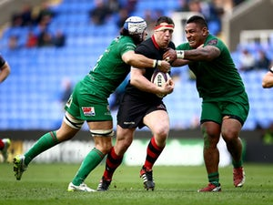 Alasdair Dickinson of Edinburgh is tackled by Blair Cowan and Halani Aulika of London Irish during the European Rugby Challenge Cup Quarter Final between London Irish and Edinburgh Rugby at the Madejski Stadium on April 5, 2015
