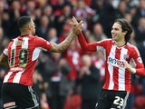 Jota of Brentford celebrates scoring his goal with Andre Gray during the Sky Bet Championship match between Brentford and Wigan Athletic at Griffin Park on May 2, 2015