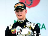 Mick Schumacher, son of former F1 champion Michael Schumacher, celebrates after winning the trophy for the best rookie after the first race of the ADAC Formula Four championship in Oschersleben, Germany, on April 25, 2015