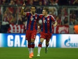 Bayern Munich's Moroccan defender Medhi Benatia (L) and Bayern Munich's midfielder Bastian Schweinsteiger react after a goal during the UEFA Champions League football match second leg semi final FC Bayern Munich vs FC Barcelona in Munich on May 12, 2015