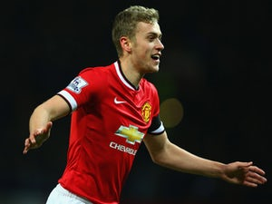 Manchester United's young striker James Wilson celebrates a goal against Cambridge United on February 3, 2015