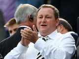 Newcastle United's English owner Mike Ashley applauds as he waits for the kick off in the English Premier League football match between Newcastle United and West Ham United at St James Park, Newcastle-Upon-Tyne, north east England on May 24, 2015