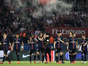 Paris Saint-Germain's Uruguyan forward Edinson Cavani is congratulated by teammates after his goal during the French L1 football match between Paris Saint-Germain (PSG) vs Reims on May 23, 2015