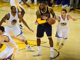 LeBron James of the Cleveland Cavaliers with the ball as Golden State Warriors' Stephen Curry tries to steal during game one of the NBA Finals at Oracle Arena on June 4, 2015