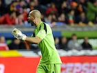 Finland's goalkeeper Niki Maenpaa celebrates his team's equalizer goal during the FIFA 2014 World Cup qualifier football match Spain vs Finland at the Molinon stadium in Gijon on March 22, 2013