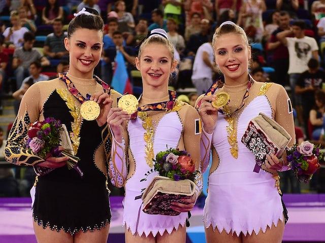 Gold medalists Ineke Van Schoor, Kaat Dumarey and Julie Van Gelder of Belgium pose with the medals won during the Acrobatic Gymnastics Women's Group Balance final on day nine of the Baku 2015 European Games at the National Gymnastics Arena on June 21, 201