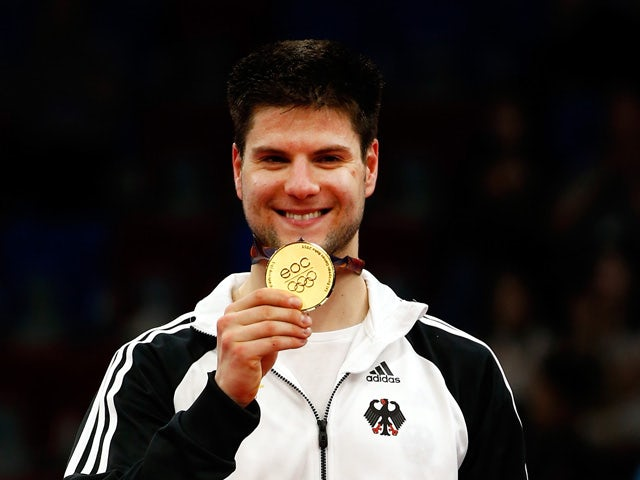 Gold medalist Dimitrij Ovtcharov of Germany stands on the podium after the Men's Table Tennis Finals during day seven of the Baku 2015 European Games at the Baku Sports Hall on June 19, 2015