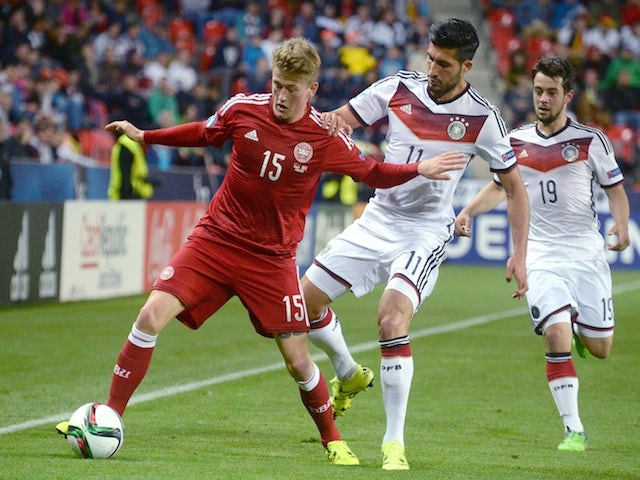 Germany's Emre Can (R) vies for a ball with Denmark's Nicolaj Thomsen during the final tournament of the EURO U21 2015, group A, match between Germany and Denmark on June 20, 2015