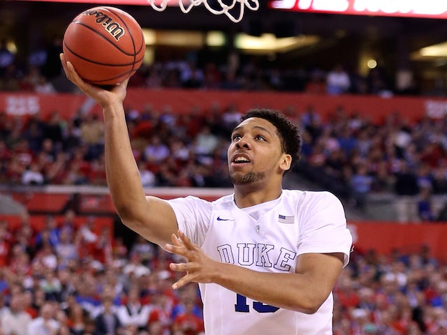 Jahlil Okafor #15 of the Duke Blue Devils drives to the basket against Frank Kaminsky #44 of the Wisconsin Badgers in the second half during the NCAA Men's Final Four National Championship at Lucas Oil Stadium on April 6, 2015